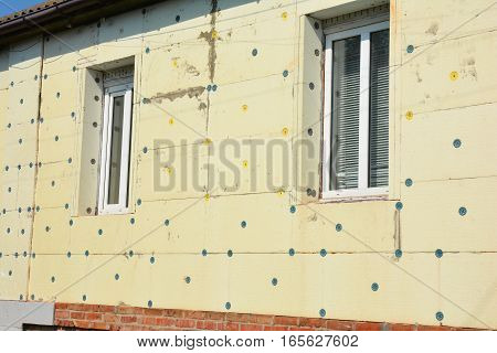 Close up on Exterior House Wall Insulation with Styrofoam Sheet Insulation. House Energy Saving Insulation.