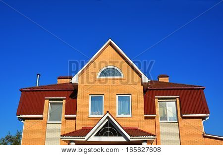 New Modern Brick House Facade with Roof Windows and Attic Dormers Exterior.