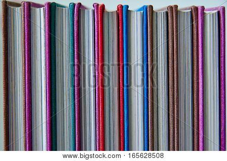 row of multicolored hardcover book. Closed  book.