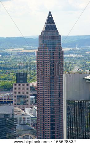 Skyscraper in Frankfurt am Main on a background of blue sky.