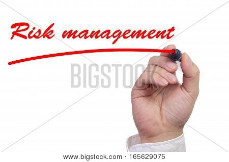 Hand underlining the work risk management in red isolated on white