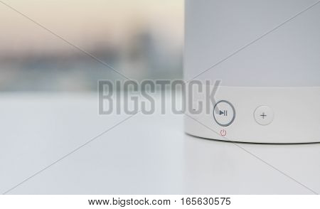 Close up on off button of wireless speaker