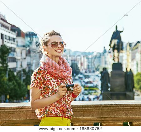 Woman On Vaclavske Namesti In Prague With Digital Camera