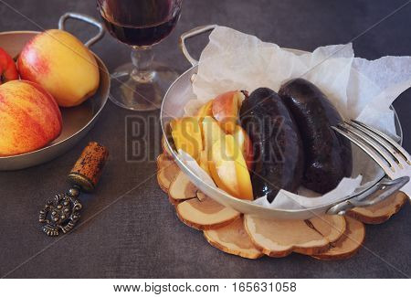 Traditional French cuisine: Blood sausage apples and glass of red wine