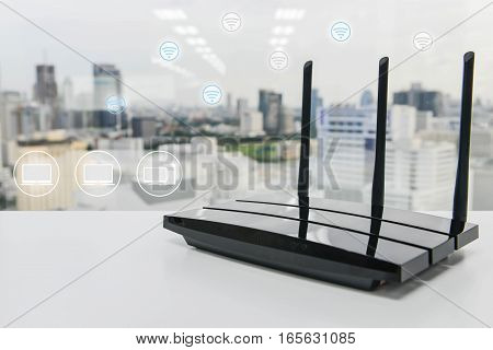 Black three poles wifi router on the white table with wifi and computer icon