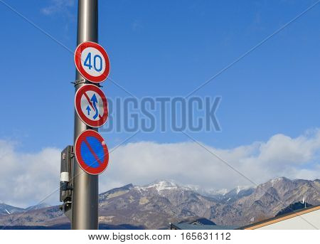 Traffic Signs for Speed limits prohibiting overtaking and No parking with mountain and blue sky background