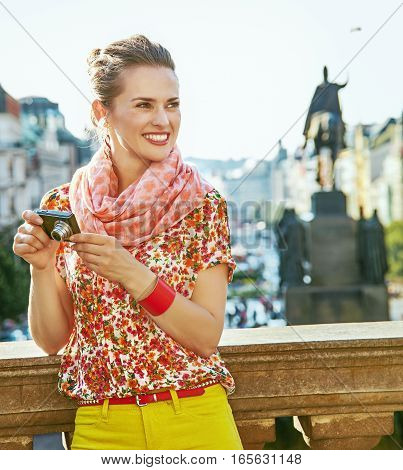 Tourist Woman With Digital Camera On Vaclavske Namesti In Prague