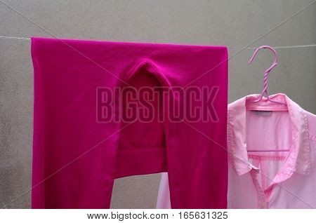 pink legging and shirt on clothes line