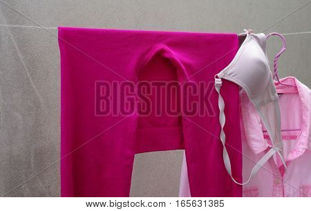 cleaning pink legging and pink shirt on clothes line