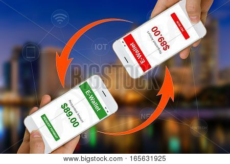 Concept of Fintech or financial technology shown by using smartphone and e-wallet app to transfer money of make payment.