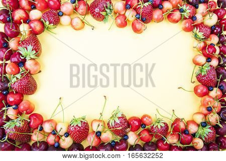 Frame Made From Fruits On A Yellow Background
