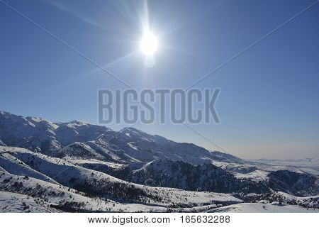 Sunny day in winter in the mountains