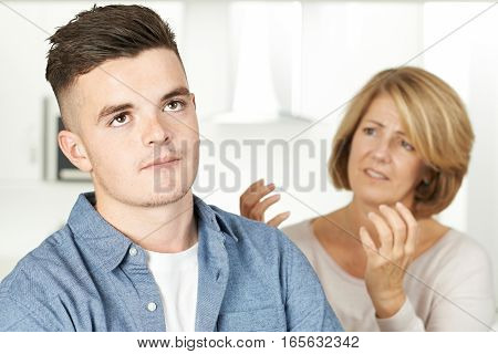 Mother Arguing With Teenage Son At Home