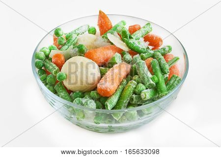 Frozen vegetables in glass bowl isolated on white background