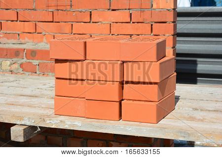 Close up on Bricklaying House Construction Site. How To Lay Bricks Like A Bricklayer