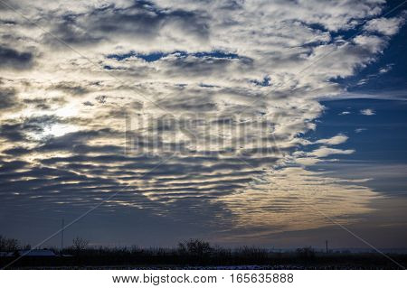 vertical stratus cloud formation , Romania .
