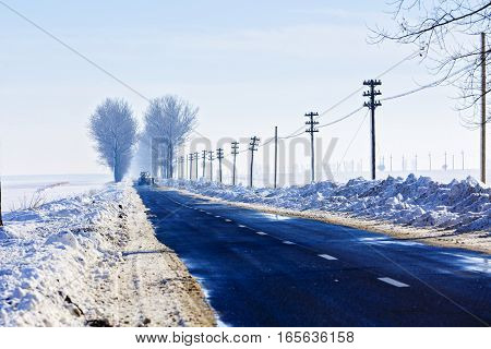 Winter Landscape With A Road In Romania