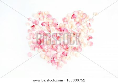 Heart symbol made of pink rose petals. Valentine's day background. Flat lay top view