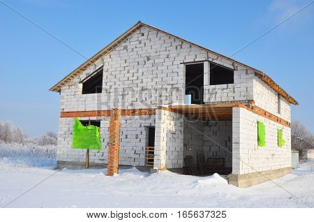 New House building from autoclaved aerated concrete blocks. Winter house construction site.