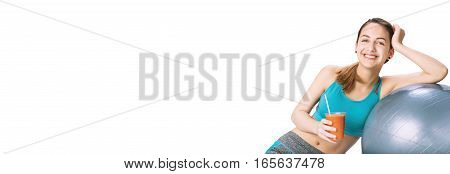 Young woman drinking fresh healthy smoothie after workout. Fitness and healthy lifestyle concept. Isolated on the white.