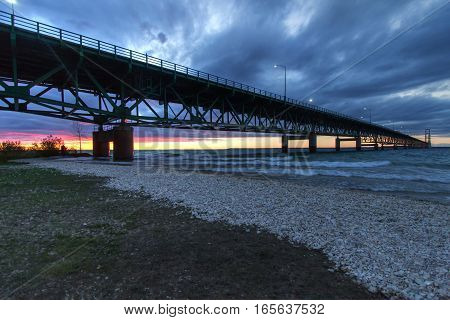 Mackinaw Bridge. The Mackinac Bridge is one of the longest suspension bridges in the world. It connects Michigan's Upper and Lower Peninsula. It is also part of the North Country Trail.