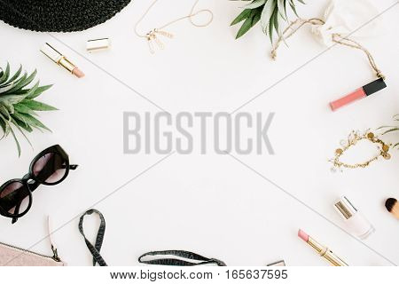 Summer casual style. Frame of modern woman clothes and accessories collage. Dress sunglasses hat purse lipstick and pineapples. Flat lay top view
