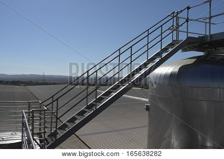 Diagonal Stairway At A Brewery Tank Farm
