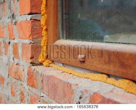 Close up on window insulation with foam. If you replace your windows and doors you will want to insulate around the opening with spray foam insulation.