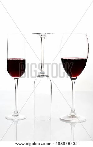 glasses with red wine on a light background