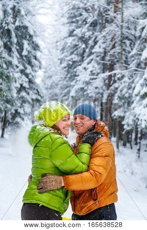 Active Family Walking In The Winter Forest.