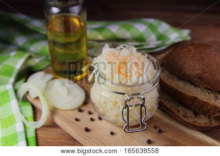 sauerkraut in a glass jar with onion,pepper ,butter and bread