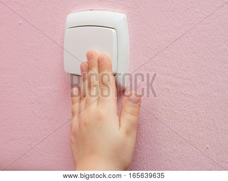 Child's Hand Presses The Light Switch, Close-up