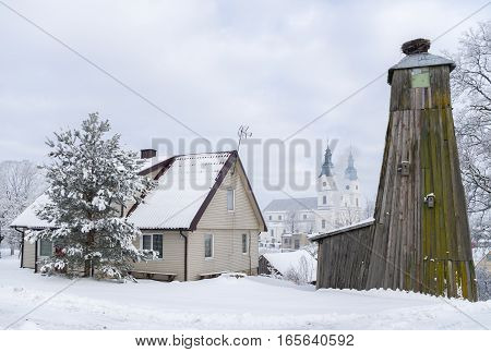 Winter landscape with village church and houses