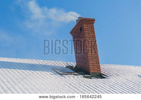 Chimney On Rooftop Of House In Winter
