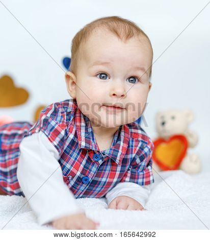 Valentine's day baby lying on white background and hearts