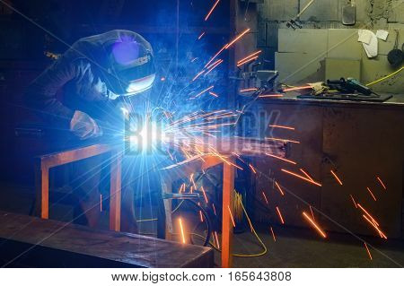 Working Welder Welds Parts Factory
