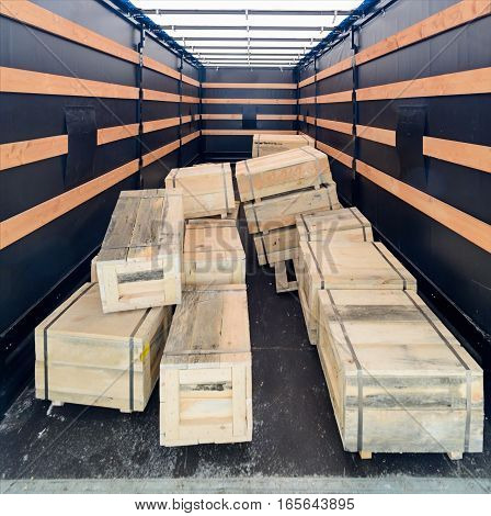 Several Wooden Crates Inside The Cargo Semitrailer.