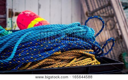 Buoy and colorful rope at a harbour in prince edward island