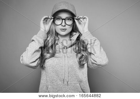 Cute Positive Blonde Woman In A Pink Baseball Cap