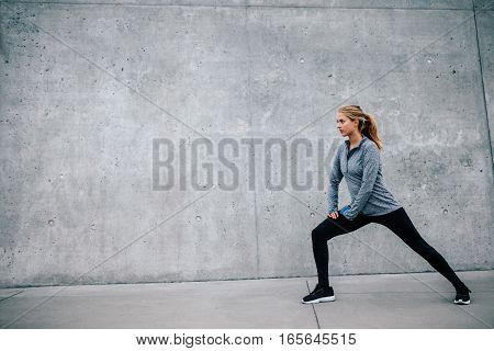 Fit Young Woman Doing Stretching Workout