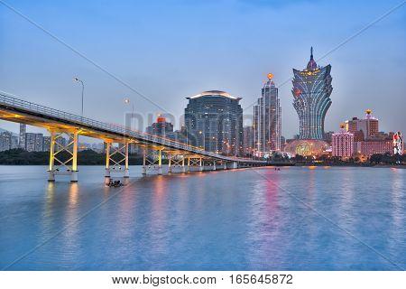 Macau China - March 11 2016: Casino Building and Macau cityscape skyline at night in Macau China.