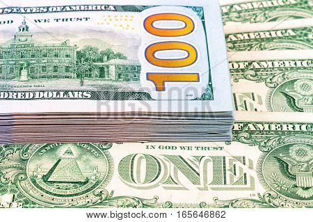 Stack of one hundred american dollar bills close up