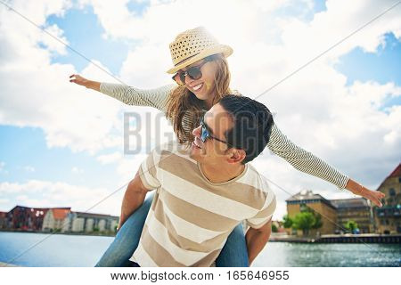 Happy Young Couple Enjoying The Summer Sun