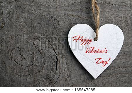 Happy Valentines Day background.Decorative white wooden heart on old wooden background with copy space.Saint Valentine's Day concept.Selective focus.Saint Valentine's Day concept.