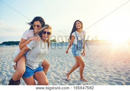 Three Cheerful Female Friends On Summer Vacation
