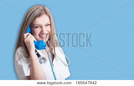 Smiling And Friendly Medical Doctor With Telephone