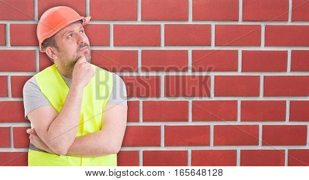 Pensive Young Man Builder With Hard Hat
