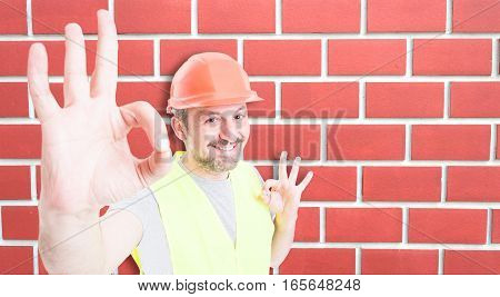 Attractive Builder Showing Okay Sign With Happiness