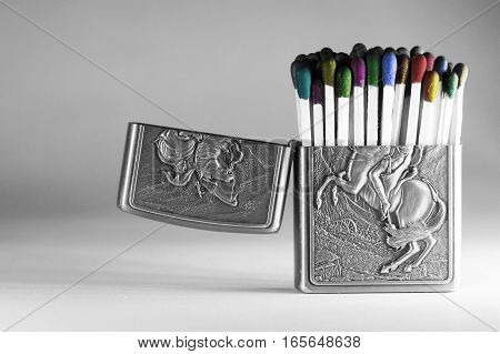 Colorful matchsticks in a lighter case isolated