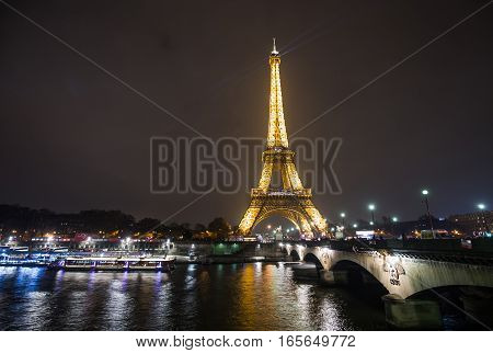 Eiffel Tower Illuminated at night is a magnet for tourists.  Paris, France - December 2016